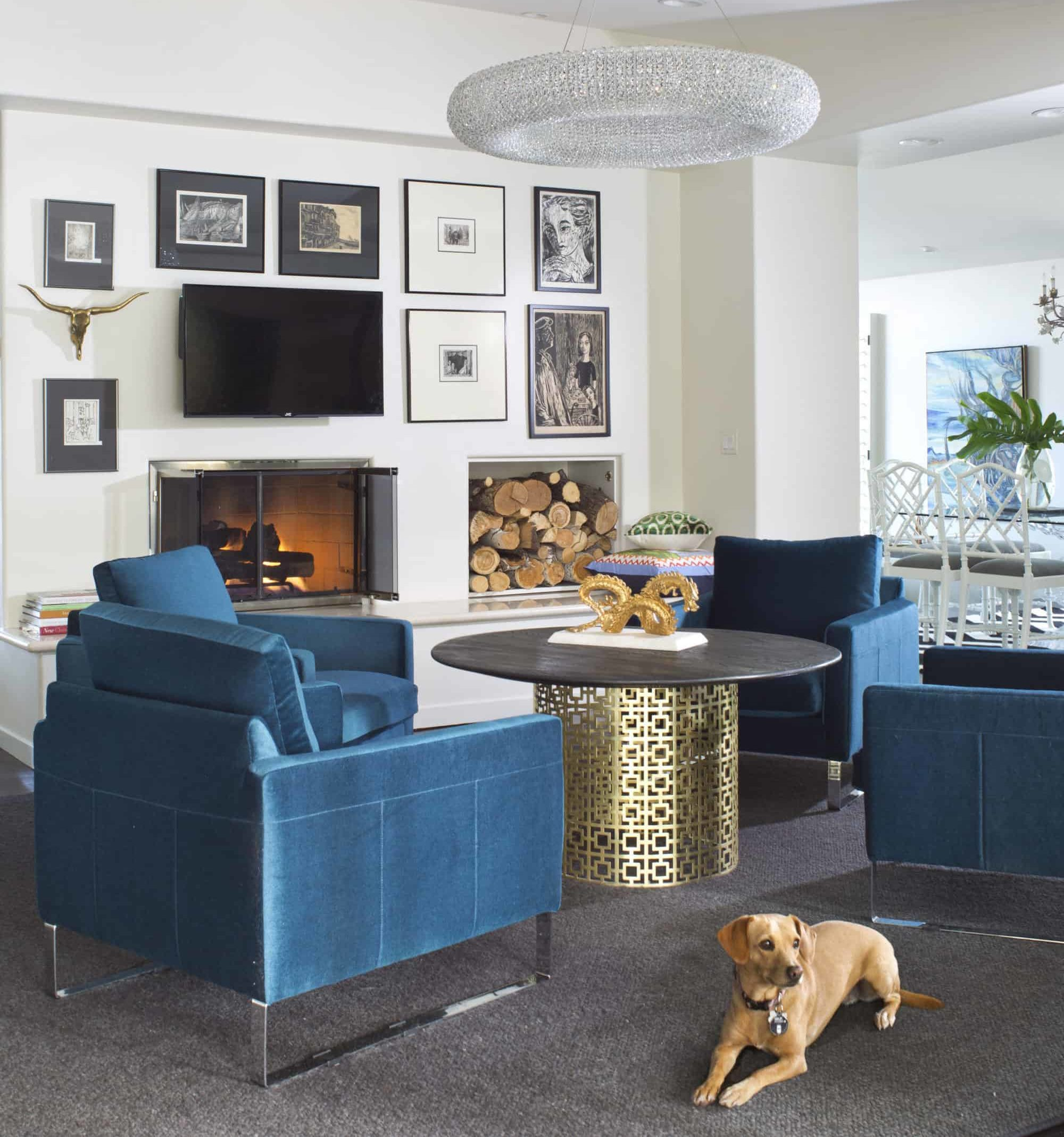 Gold tea table and blue arm chairs