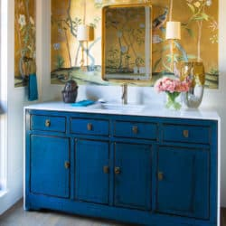 Gorgeous powder room with bamboo on gilded silk wallpaper